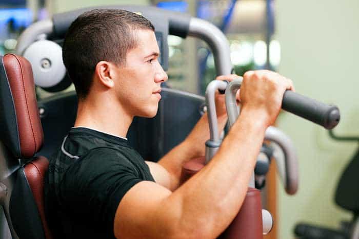 Man on weight machines
